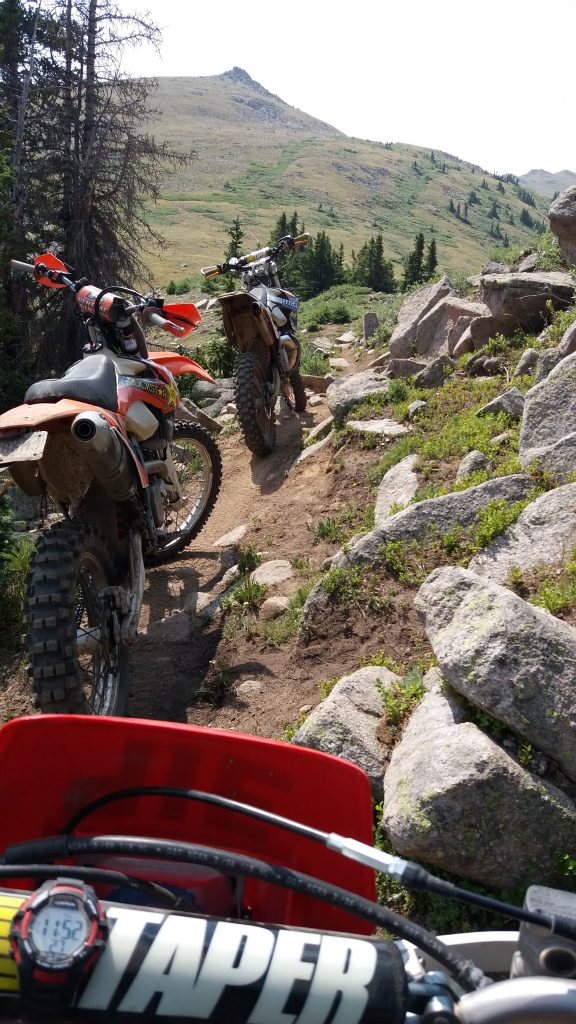 Riding dirt bikes on singletrack trails in the Colorado mountains