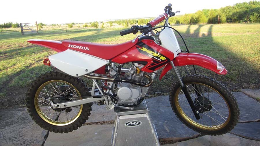 The XR100 is a great beginner bike for a 13 year old because it's cheap and reliable.