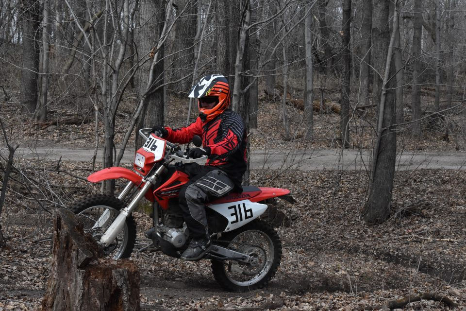 Learning to safely ride a dirt bike on the trail.