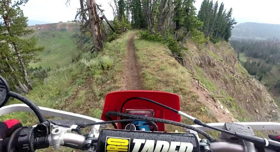 Riding on a ridge on a dirt bike trail