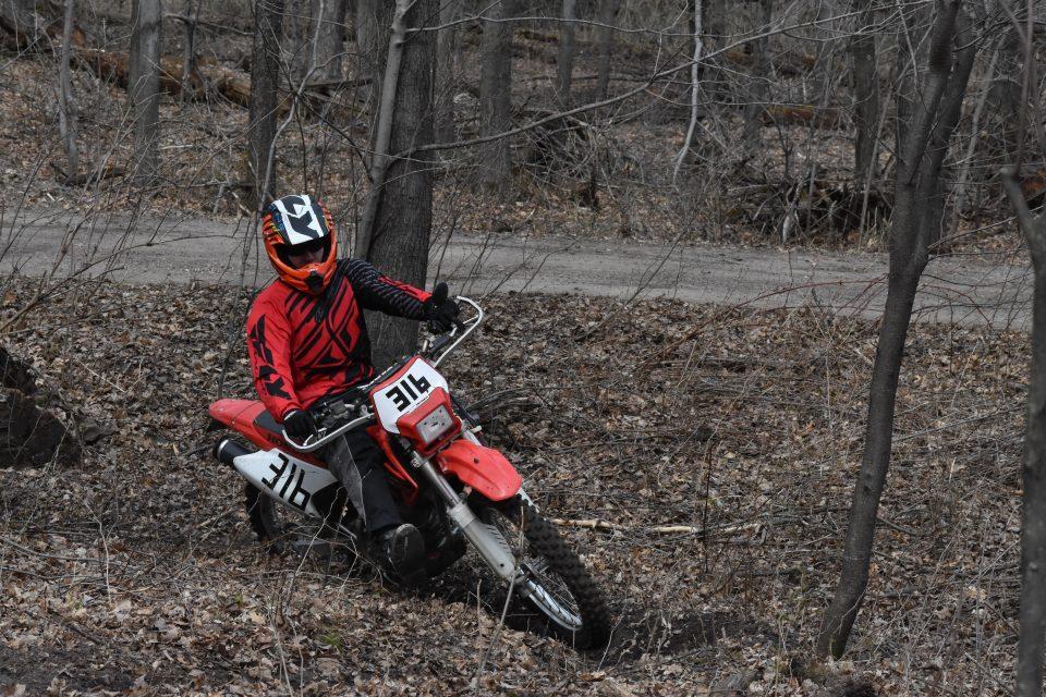 Using my leg while cornering on a single track dirt bike trail